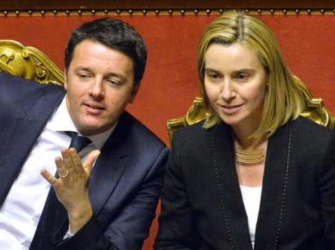 Matteo Renzi (L) and Foreign Affairs Minister Federica Mogherini are seen during a debate for a confidence vote at Italian Senate on February 24, 2014 in Rome.  Italy's new Prime Minister Matteo Renzi was to unveil details of his ambitious government programme as he faced a confidence vote in parliament in a key test of his power to unite warring factions and secure a solid majority. The new premier is expected to present plans for rapidly overhauling the tax system, job market and public administration in his speech to the Senate, which will put his newly-formed cabinet to a confidence vote.        AFP PHOTO / ANDREAS SOLARO        (Photo credit should read ANDREAS SOLARO/AFP/Getty Images)